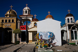 """Large chapels are built in the cemetary in Culiacan, Mexico, known locally as the """"Pantheon"""".  Some of the chapels, where the dead are buried, are two-story buildings complete with electricity and air conditioning.  This phenomenon, where people build increasingly large, luxurious memorials to their dead family members, is often associated with Mexico's Narco Culture."""