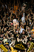SHOT 2/14/13 8:41:21 PM - Colorado basketball fans hold up a cutout of head coach Tad Boyle while cheering against Arizona during their regular season Pac-12 basketball game at the Coors Event Center on the Colorado campus in Boulder, Co. Colorado won the game 71-58. The student cheering section is nicknamed the C-Unit. (Photo by Marc Piscotty / © 2013)