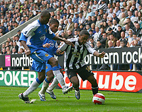 Photo: Andrew Unwin.<br />Newcastle United v Wigan Athletic. The Barclays Premiership. 19/08/2006.<br />Newcastle's Charles N'Zogbia (R) looks to shield the ball.