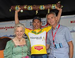 06.07.2017, Kitzbühel, AUT, Ö-Tour, Österreich Radrundfahrt 2017, 4. Etappe von Salzburg auf das Kitzbüheler Horn (82,7 km/BAK), Siegerehrung, im Bild Stefan Denifl (AUT, Team Aqua Blue Sport) im gelben Trikot // Stefan Denifl of Austria (Aqua Blue Sport) in the yellow jersey on podium during the 4th stage from Salzburg to the Kitzbueheler Horn (82,7 km/BAK) of 2017 Tour of Austria. Kitzbühel, Austria on 2017/07/06. EXPA Pictures © 2017, PhotoCredit: EXPA/ Reinhard Eisenbauer
