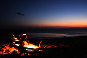 Camp fire on the beach next to the coast of the Atlantic Ocean, on the barrier island of Shackleford Banks, North Carolina.