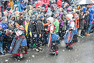 Imst Schemenlaufen, a traditional carnival held only once every four years in Imst, Tirol, Austria (31 January 2016). The Schemenlaufen is inscribed on the UNESCO list of Intangible Cultural Heritage. Pictured, the Wifligsackner, who clear the crowd from the procession route by swinging a large 'ball' stuffed with dried corn leaves. © Rudolf Abraham