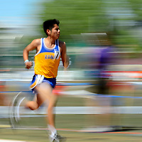 051014       Adron Gardner<br /> <br /> Zuni Thunderbird Alex Eustace is a blur of speed during the AA boys 3200m race at the State Track Meet at the University of New Mexico in Albuquerque Saturday.  Eustace finished in second place with a time of 10:02.17.
