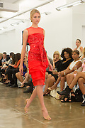 Red dress. By Carmen Marc Valvo at the Spring 2013 Fashion Week show in New York.