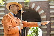 Bandleader Michael Aranella introducing a song at the Jazz Age Lawn Party. Aranella started the lawn party as a small event, and it has grown to be very popular, running for two weekends in June and August.