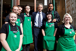 © under license to London News Pictures. 25/06/12..UK managing director of Starbucks Kris Engskov with young apprentices at the coffee house where Boris Johnson visited today which is part of a commitment to hire a large number of apprentices across the capital. ..ALEX CHRISTOFIDES/LNP