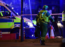 """A paramedic rushes to the scene as police are dealing with a """"major incident"""" at London Bridge."""