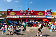 Ruby's Barr & Grill, on the Coney Island boardwalk has been open since 1972, and occupies the same space as a bar that opened in 1934. Ruby's preserved parts of the original wooden boardwalk inside, where you can walk under it.