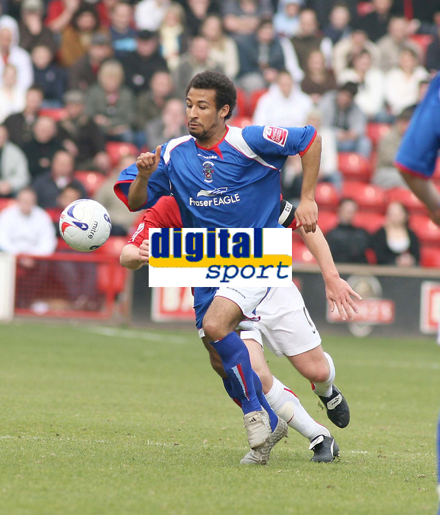 Photo: Mark Stephenson.<br />Walsall v Accrington Stanley. Coca Cola League 2. 31/03/2007. Accrington's Romauld Boco wins the ball