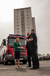 EMBARGOED UNTIL 00:01 24 April 2019<br />Pictured: Ash Denham chats to Willie Pollard Station Manager and Kenny Rogers Local Senior Officer (grey hair)<br /><br />Today, Community Safety minister Ash Denham launched the Scottish Government's consultation on Strengthening Fire Safety for High Rise Domestic Buildings following the Grenfell Tower fire in London.  Ms Denholm was joined by Assistant Chief Fire Officer Ross Haggart and Mark McHale, building manager of Wauchope House, <br /><br /><br />Ger Harley | EEm 23 April 2019