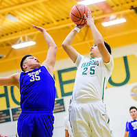 Zuni Thunderbird Jared Sosseah (35) contests a shot from Thoreau Hawk Angel Chee (25) at Thoreau High School Thursday.