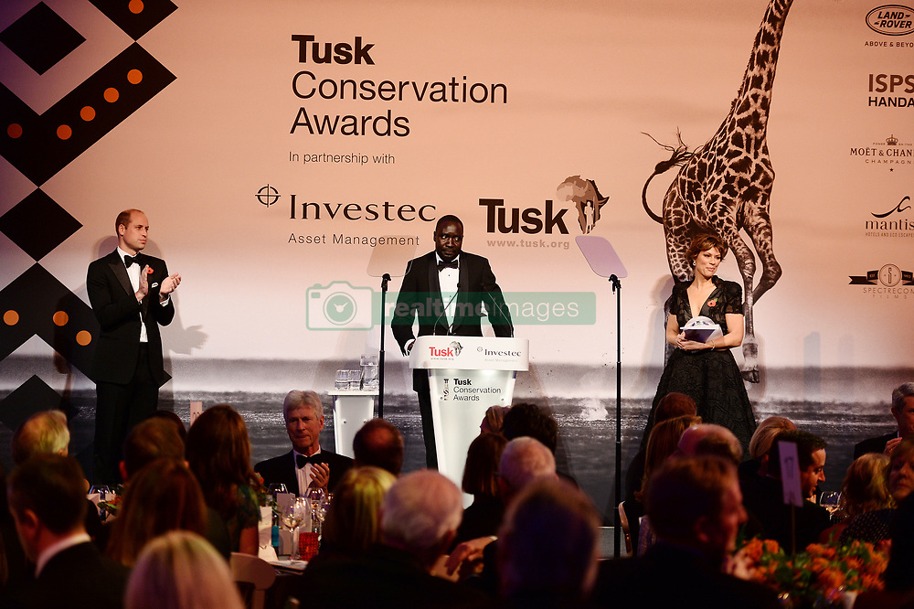 Vincent Opyene receives the Prince William Award for Conservation, as the Duke of Cambridge and Kate Silverton look on druing the Tusk Conservation Awards at Banqueting House, London.