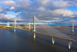 Aerial view of the Queensferry Crossing bridge spanning the Firth of Forth river in Scotland, UK.