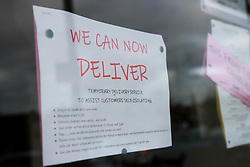 A sign visible in a restaurant window reading 'we can deliver' taken during the Corona Virus Pandemic of 2020<br /> <br /> <br /> Ben Booth | 20/03/2020