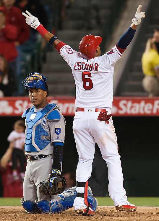 The Angels Yunel Escobar celebrates past Royals catcher Salvador Perez after his solo home run in the sixth inning Wednesday night at Angel Stadium.<br /> <br /> ///ADDITIONAL INFO:   <br /> <br /> angels.0428.kjs  ---  Photo by KEVIN SULLIVAN / Orange County Register  --  4/27/16<br /> <br /> The Los Angeles Angels take on the Kansas City Royals Wednesday at Angel Stadium.<br /> <br /> <br />  4/27/16