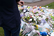 Two days after the killing of the Conservative member of parliament for Southend West, Sir David Amess MP, Catholic rosary beads and floral tributes left in Eastwood Road North, a short distance from Belfairs Methodist Church in Leigh-on-Sea, on 17th October 2021, in Leigh-on-Sea, Southend , Essex, England. Amess was conducting his weekly constituency surgery when attacked with a knife by Ali Harbi Ali.