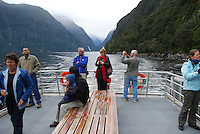 Milford Sound is New Zealand's top tourist destination. It was described by Rudyard Kipling as the Eigth Wonder of the World. Geographically it is not a sound but a fijord. It is 15 kilometres long and its sheer rock interfaces rise to 1200 metres. 201004055028..© Victor Patterson, 54 Dorchester Park, Belfast, N Ireland. Tel: +44 2890661296; Mobile: +44 7802 353836; Emails: victorpatterson@me.com & victorpatterson@gmail.com; www.victorpatterson.com