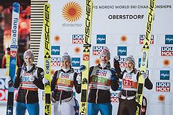 28.02.2021, Oberstdorf, GER, FIS Weltmeisterschaften Ski Nordisch, Oberstdorf 2021, Mixed Teambewerb, Skisprung HS106, Siegerehrung, im Bild Silbermedaillen Gewinner Halvor Egner Granerud (NOR), Maren Lundby (NOR), Robert Johansson (NOR), Silje Opseth (NOR) // during the winner ceremony for the ski jumping HS106 mixed team competition of FIS Nordic Ski World Championships 2021 in Oberstdorf, Germany on 2021/02/28. EXPA Pictures © 2021, PhotoCredit: EXPA/ JFK