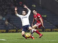 Preston North End's Ben Pearson goes down under the challenge from Middlesbrough's Stewart Downing<br /> <br /> Photographer Rich Linley/CameraSport<br /> <br /> The EFL Sky Bet Championship - Preston North End v Middlesbrough - Monday 1st January 2018 - Deepdale Stadium - Preston<br /> <br /> World Copyright © 2018 CameraSport. All rights reserved. 43 Linden Ave. Countesthorpe. Leicester. England. LE8 5PG - Tel: +44 (0) 116 277 4147 - admin@camerasport.com - www.camerasport.com