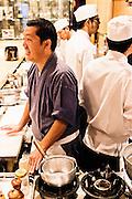 Chef Nakamura with staff at Nakamura restaurant.