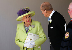 Queen Elizabeth II talks with the Duke of Edinburgh after the wedding ceremony of Prince Harry and Meghan Markle at St. George's Chapel in Windsor Castle.