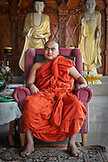 A Buddhist priest inside the Dhammikarama Burmese Buddhist Temple located on Penang, Malaysia.