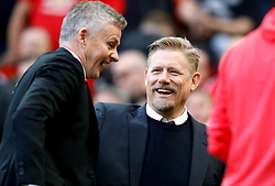 Manchester United caretaker manager Ole Gunnar Solskjaer (left) speaks to former Manchester United player Peter Schmeichel during the Premier League match at Old Trafford, Manchester.