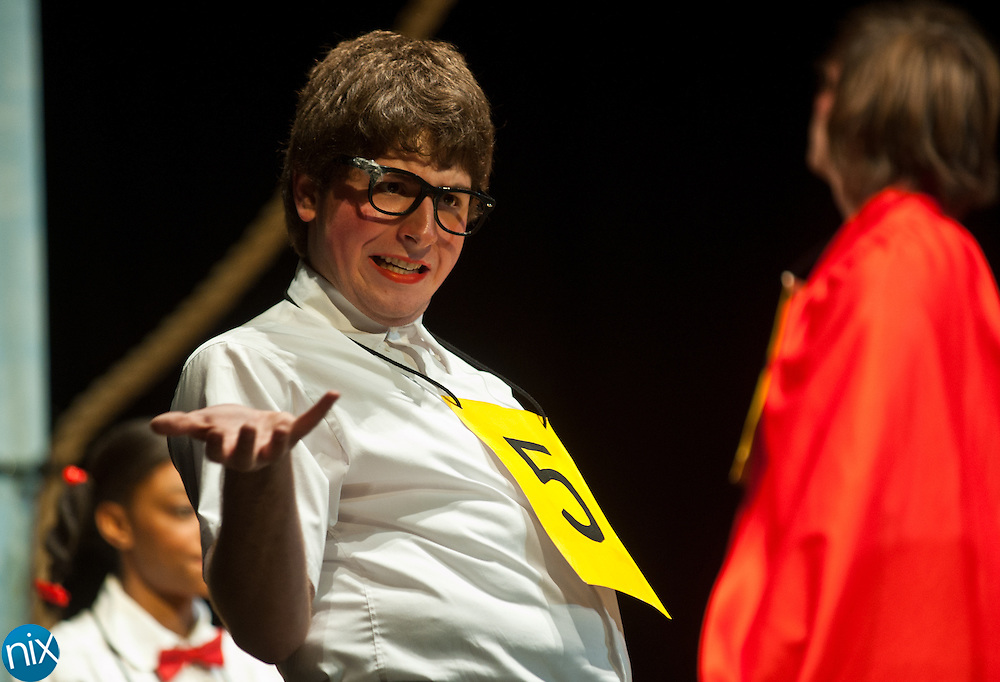 """Hickory Ridge student Nathan Singer performs as the character William Barfee during a dress rehearsal of the school's production of """"The 25th Annual Putnam County Spelling Bee"""" Monday afternoon. The play will run April 15-16 in Harrisburg.  (Photo by James Nix)"""