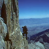 Galen Rowell prepares to ascend a rope during the first free ascent of the East Face of Keeler Needle, near Mount Whitney in California's Sierra Nevada.