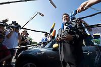 """19 AUG 2009, BERLIN/GERMANY:<br /> Sigmar Gabriel, SPD, Bundesumweltminister, praesentiert Elektro-Minis von BMW anl. der Verabschiedung des """"Nationalen Entwicklungsplans Elektromobilitaet"""" durch das B undesk abinett, Paul-Loebe-Allee / Willy-Brandt-Str.<br /> IMAGE: 20090819-01-016<br /> KEYWORDS: BMW Mini Elektroantrieb, Auto, Wagen, Mikrofon, microphone, Kamera, camera, Journalisten, Statement"""