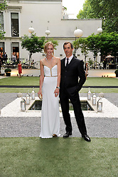 SASHA PIVOVAROVA and PHILIPPE LEOPOLD METZGER CEO of Piaget at a garden party hosted by Piaget at The Hempel Hotel, London on 14th July 2011.