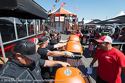 Ives Brothers Wall of Death family participate in the Weber Grill Strong Arm contest during the annual Sturgis Black Hills Motorcycle Rally.  SD, USA.  August 7, 2016.  Photography ©2016 Michael Lichter.