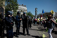 A woman is dancing in front of the police.