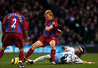 Photo: Javier Garcia/Back Page Images Mobile 07887 794393<br />03/01/2005 Crystal Palace v Aston Villa, FA Barclays Premiership, Selhurst Park<br />Aki Riihilahti is tackled by Juan Pablo Angel