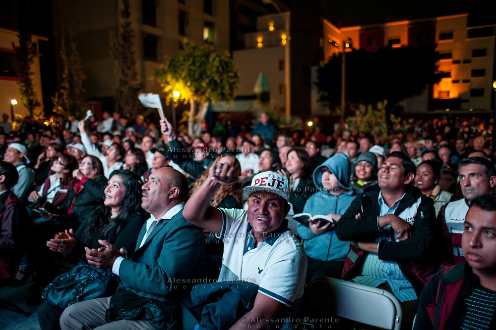 MORENA's supporter at the party house are already enjoying. AMLO has 25% of preferences<br /> more than other parties. Watching the debate in big screen.<br /> AMLO is the only hope of the low class.
