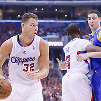 21 April 2014: Los Angeles Clippers forward Blake Griffin (32) drives past Golden State Warriors guard Klay Thompson (11) on a screen set by Los Angeles Clippers guard Chris Paul (3) during the Los Angeles Clippers 138-98 victory over the Golden State Warriors, during Game Two of the Western Conference Quarterfinals of the NBA Playoffs, at the Staples Center, Los Angeles, California, USA.