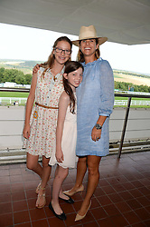 Left to right, AMBER KNATCHBULL, GWENDELINE ENGLISH and ISABELLA KNATCHBULL at the 3rd day of the 2013 Glorious Goodwood racing festival - Ladies day at Goodwood Racecourse, West Sussex on 1st August 2013.