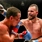 KISSIMMEE, FL - MARCH 05:   Yomar Alamo punches Jesus Alberto Beltran during the Boxeo Telemundo All Star Boxing event at Osceola Heritage Park on March 5, 2021 in Kissimmee, Florida. (Photo by Alex Menendez/Getty Images) *** Local Caption *** Yomar Alamo; Jesus Alberto Beltran
