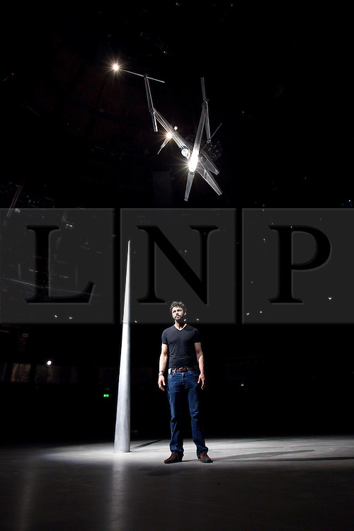 © Licensed to London News Pictures. 31/07/2013. London, UK. British artist Conrad Shawcross is seen with his large scale light installation 'Timepiece', at the press view for Bloomberg's Summer at the Roundhouse in London today (31/07/2013). The specially commission piece, which was created in response to the Roundhouse's iconic main space using its 24 pillars to mark the hours of the day, forms part of of Bloomberg's 'Summer at the Roundhouse' and will be open to the public from the 1st to the 25th of August 2013. Photo credit: Matt Cetti-Roberts/LNP