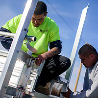 020315       Cable Hoover<br /> <br /> Steven Rue, left, and Felix Jaramillo assemble new bleachers at Ford Canyon Park in Gallup Tuesday. Both men work for a Roswell-based contractor that is set to complete 25 sets of bleachers this week for ongoing renovations of the park's baseball and softball fields.