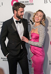 "(FILE) Miley Cyrus and Liam Hemsworth Donate $500,000 to Emergency Relief After Losing Home in California Wildfires. Miley Cyrus and Liam Hemsworth lost their home to a California wildfire, but the famous couple have their sights set on rebuilding not just their house but also their community. Cyrus and Hemsworth have donated $500,000 to The Malibu Foundation through Cyrus' charity, Happy Hippie, a representative said. The funds will be used for ""those in financial need, emergency relief assistance, community rebuilding , wildfire prevention and climate change resilience,"" according to a statement. Earlier on Tuesday, Hemsworth shared a striking photo of their home's remains. WEST HOLLYWOOD, LOS ANGELES, CA, USA - MARCH 04: Actor Liam Hemsworth and girlfriend/singer Miley Cyrus arrive at the 26th Annual Elton John AIDS Foundation's Academy Awards Viewing Party held at The City of West Hollywood Park on March 4, 2018 in West Hollywood, Los Angeles, California, United States. 04 Mar 2018 Pictured: Liam Hemsworth, Miley Cyrus. Photo credit: Xavier Collin/Image Press Agency/MEGA TheMegaAgency.com +1 888 505 6342"