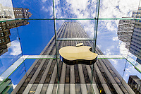 New York City Apple store on 5th Avenue is an iconic glass cube in the middle of a bustling city atmosphere.