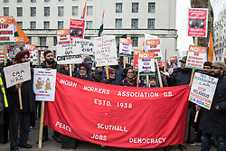London, UK. 25 January, 2020. Hundreds of people protest opposite Downing Street against the government of Narendra Modi as part of a 'National demonstration against fascism in India' organised by groups including South Asia Solidarity Group, Tamil People in the UK, Kashmir Solidarity Movement, Indian Workers Association (GB) and Indian Muslim Federation(UK). Representatives of the groups spoke out against moves by the Modi government to turn India into a Brahmanical Hindu state, the Citizenship Amendment Act (CAA), the National Register of Citizens (NRC), state-sponsored violence against minorities and dissenters and colonialism with regard to Kashmir.