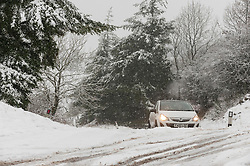 © Licensed to London News Pictures. 29/12/2020. Llanfihangel Nant Melan, Powys, Wales, UK. Motorists drive through winter weather on a road near Llanfihangel Nant Melan in Powys, Wales, UK. Photo credit: Graham M. Lawrence/LNP