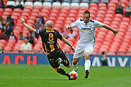 Keith Graydon of Morpeth Town AFC puts in a tackle on Mike Symons of Hereford FC during the FA Vase match between Hereford FC and Morpeth Town at Wembley Stadium, London, England on 22 May 2016. Photo by Mike Sheridan.
