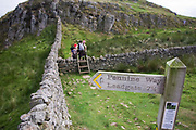 Walkers explore paths along Roman Emperor Hadrian's Wall, once the northern frontier of Rome's empire from Barbarian tribes. Hadrian's Wall (Latin: Vallum Aelium) was a stone and timber fortification built by the Roman Empire across the width of what is now northern England. Begun in AD 122, during the rule of emperor Hadrian, it was built as a military fortification though gates through the wall served as customs posts to allow trade and levy taxation. The 4.5m high Wall was 80 Roman miles (73.5 miles, 117km) long and so important was it to secure its length that up to 10% of the Roman army total force were stationed here. Tough walkers generally take 7 days to trek its coast-to-coast length.