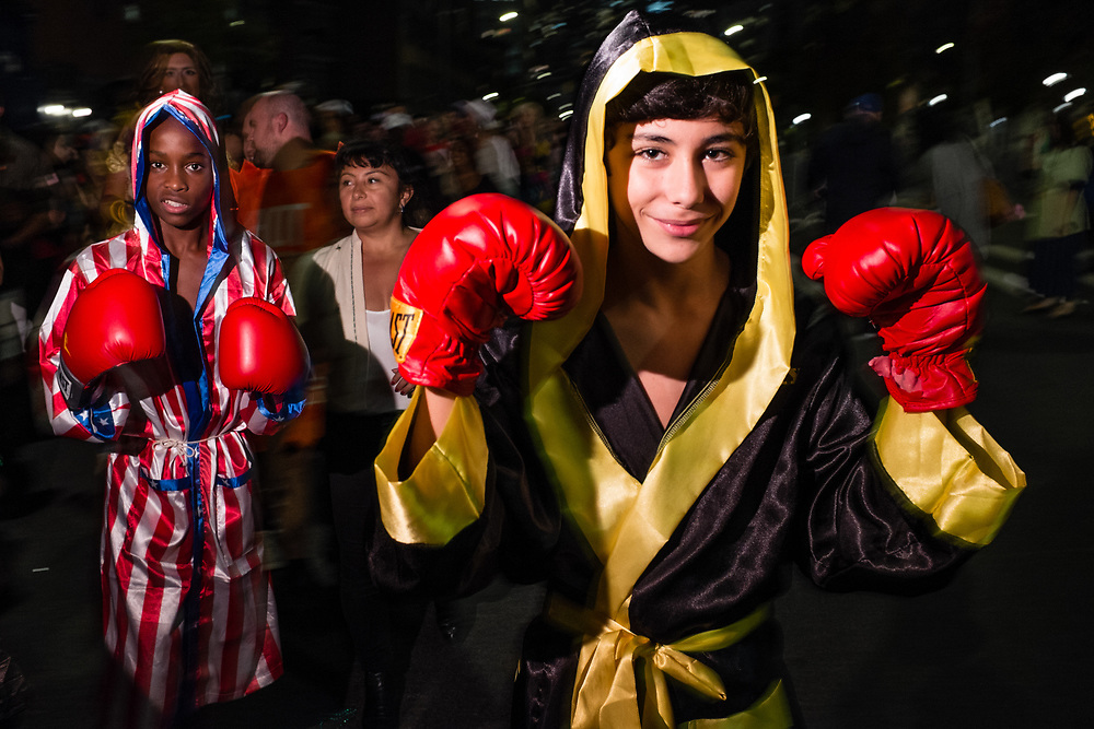 New York, NY - 31 October 2019. the annual Greenwich Village Halloween Parade along Manhattan's 6th Avenue. Two young men costumed as boxers.