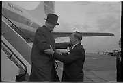 Texaco Board Of Directors..1963..03.10.1963..10.03.1963..3rd October 1963..The Board of Directors of Texaco Inc., flew into Dublin Today in two special planes for a four day inspection tour of their Irish subsidery Caltex Ireland Ltd...Picture shows Mr Dan Langan,(right),Managing Director of Caltex Irl Ltd welcoming Mr Agustus c Long, New York, Chairman Of The Texaco Board as he descends from his aircraft at Dublin Airport.