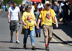 Watford fans make their way to the stadium before the Premier League match at Vicarage Road, Watford.