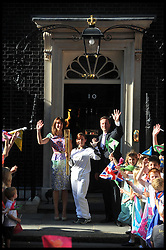 The Prime Minister David Cameron and his wife Samantha look on as Kate Nesbitt MC arrives in Downing St, with the Olympic torch relay on the eve of the Olympic games, Thursday July 26, 2012. Photo by Andrew Parsons/i-Images.All Rights Reserved ©Andrew Parsons.See Instructions